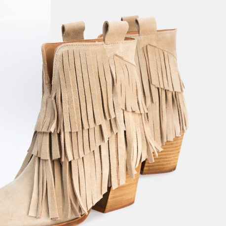 Beige Fringed suede leather ankle boots Given