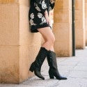 Black embroidered leather cowboy boots Given